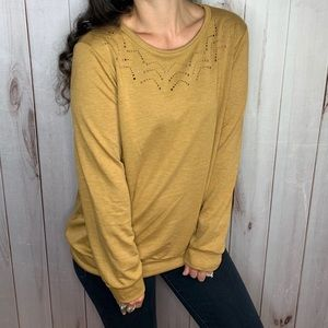 Laser cutout French terry top